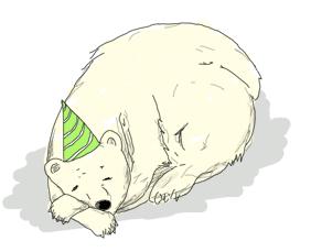 A sleeping polar bear with a birthday hat